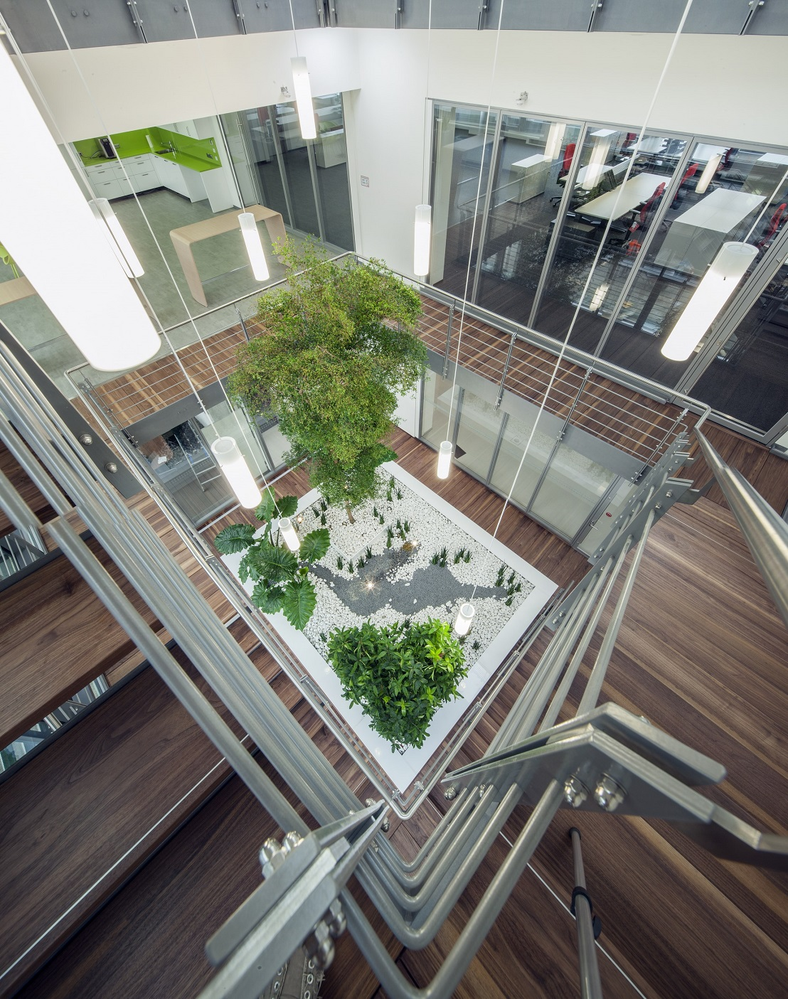 Atrium as a green patio on the stairs - trees and plants provide oxygen - near Munich